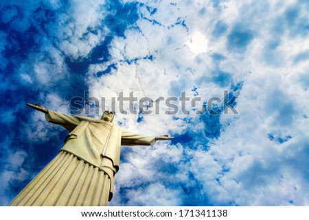 Christ the redeemer statue in Rio de Janeiro against blue sky - stock photo