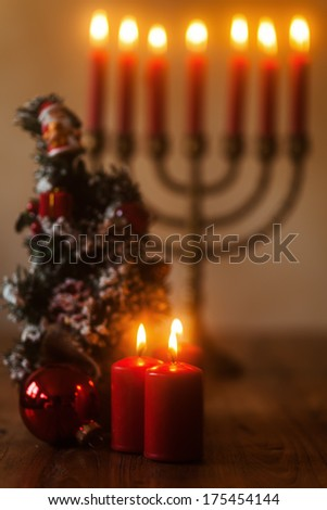 christams arrangement with candles and a christmas ball - stock photo