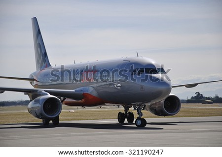 CHRISTCHURCH, CIRCA 2010: A Jetstar Airbus 320 at Christchurch International Airport, New Zealand
