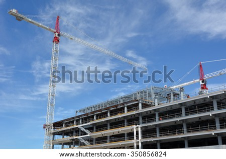 CHRISTCHURCH - DEC 04 2015:Builders builds a new building in Christchurch.Over 1000 buildings in the CBD (Central Business District) were demolished following Christchurch earthquakes - stock photo