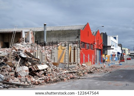 CHRISTCHURCH, NEW ZEALAND - APRIL 01: Commercial buildings and warehouses on the southern side of St. Asaph Street after the earthquake on April 01, 2011 in Christchurch. - stock photo