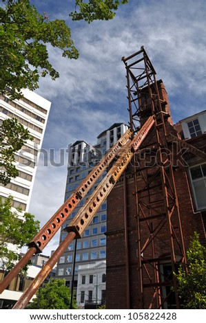 CHRISTCHURCH, NEW ZEALAND - DECEMBER 27: Steel props are  erected to try and save one of the oldest and most significant earthquake damaged buildings on December 27, 2010 in Christchurch. - stock photo