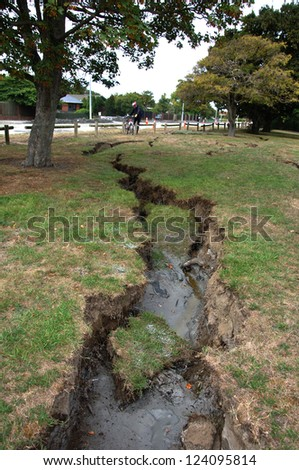 CHRISTCHURCH, NEW ZEALAND: FEB 22: Damage to parkland by the Avon River from the 6.4 earthquake in Christchurch, South Island, New Zealand, 22-2-2011 - stock photo