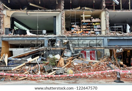 CHRISTCHURCH, NEW ZEALAND - FEBRUARY 23: Merivale fashion shops are  shaken to pieces by the latest and most devastating earthquake on February 23, 2011 in Christchurch. - stock photo