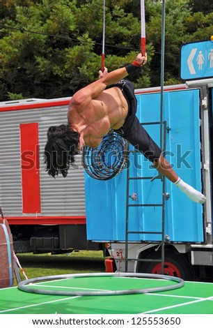 CHRISTCHURCH, NEW ZEALAND - JANUARY 21: Fuse Circus performer practicing before the Campground Chaos show at the 20th World Buskers Festival on January 21, 2013 in Christchurch. - stock photo