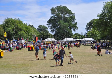 CHRISTCHURCH, NEW ZEALAND - JANUARY 21: Lunchtime Crowd in Hagley Park at the 20th World Buskers Festival on January 21, 2013 in Christchurch. - stock photo