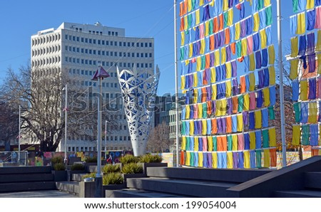 Christchurch, New Zealand - June 15, 2014: Artworks in Cathedral Square include the Chalice by Neil Dawson and recently erected Flag Wall by Sara Hughes. - stock photo