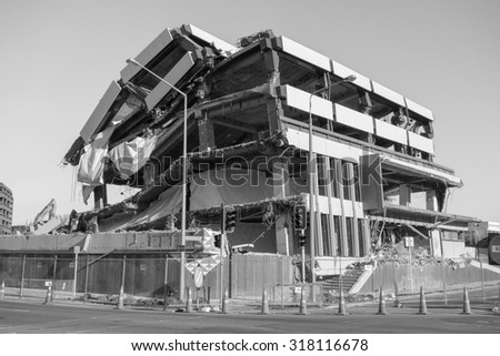 CHRISTCHURCH, NEW ZEALAND - JUNE 11, 2015: Ruins of buildings destroyed in the 2011 earthquake are still visible today in town - stock photo
