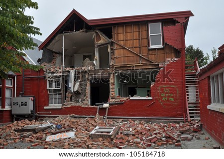 CHRISTCHURCH, NEW ZEALAND - MARCH 12: A brick house on historic Cranmer Square collapses from the impact of the massive  earthquake on March 12, 2011 in Christchurch. - stock photo