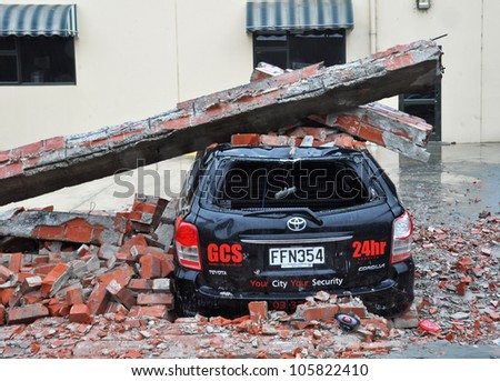 CHRISTCHURCH, NEW ZEALAND - MARCH 20: A car is crushed by a collapsed brick wall on March 20, 2011 in Christchurch following a 6.2 magnitude earthquake. - stock photo