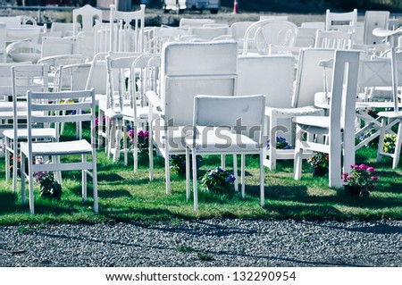 CHRISTCHURCH, NEW ZEALAND - MARCH 20, 2013: 185 empty white chairs. Reflection of Loss of Lives, Livelihoods and Living in Neighborhood by Peter Majendie on March 20, 2013 in Christchurch, New Zealand - stock photo