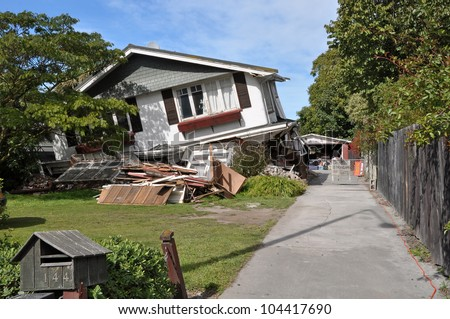CHRISTCHURCH, NEW ZEALAND - MARCH 26: House in Avonside collapses in the largest earthquake Christchurch has ever experienced - 7.1 on the Richter Scale on March 26, 2011 in Christchurch, New Zealand. - stock photo