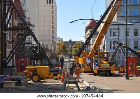 CHRISTCHURCH, NEW ZEALAND - MARCH 09: It's a hive of activity in Worcester street where workers are trying to stabilize earthquake damaged heritage buildings on March 09, 2011 in Christchurch. - stock photo