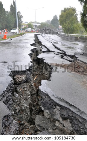 CHRISTCHURCH, NEW ZEALAND - MARCH 20: Large cracks appear in the Fitzgerald Avenue bridge following a huge earthquake on March 20, 2011 in Christchurch. - stock photo