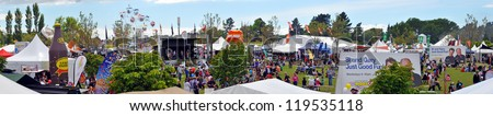 CHRISTCHURCH, NEW ZEALAND - NOVEMBER 16: Panoramic view of the fair ground and side shows area at the 2012 Canterbury A&P Show on November 16, 2012 in Christchurch. - stock photo
