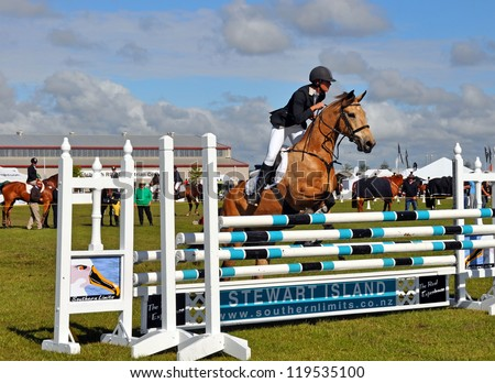 CHRISTCHURCH, NEW ZEALAND - NOVEMBER 16: Woman and horse competing in the show jumping event at The 2012 Canterbury A&P Show on November 16, 2012 in Christchurch. - stock photo