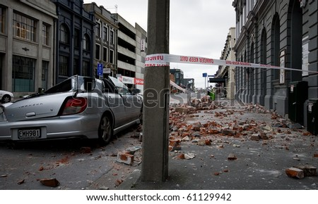 CHRISTCHURCH, NEW ZEALAND - SEPT 9: A car lies crushed following a 7.1 magnitude earthquake that struck on 4 September. Strong aftershocks continue. 9 September 2010 in Christchurch, New Zealand. - stock photo