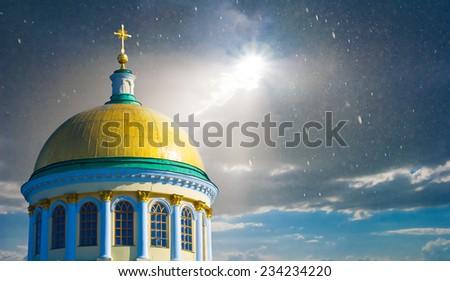 christian church on a dramatic sky background - stock photo