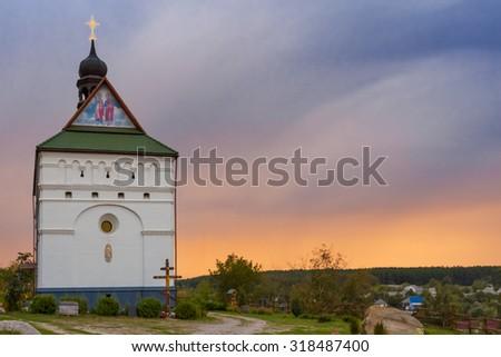 christian church on a evening sky background - stock photo