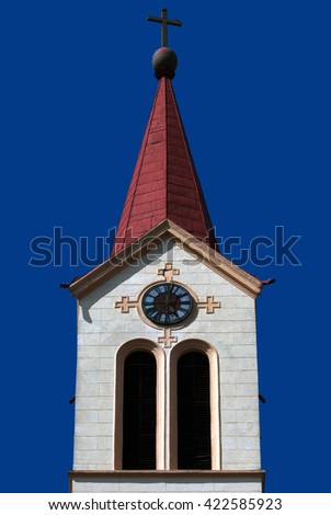 Christian church steeple with cross and clock