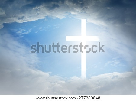 Christian cross appears bright in the sky - stock photo