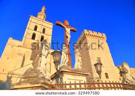 Christian cross in front of the Cathedral and Papal Palace, Avignon, Provence, France - stock photo