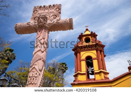 christian cross in the front of church in Bernal, Mexico