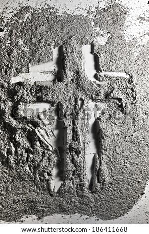 Christian cross made of grey ash - stock photo