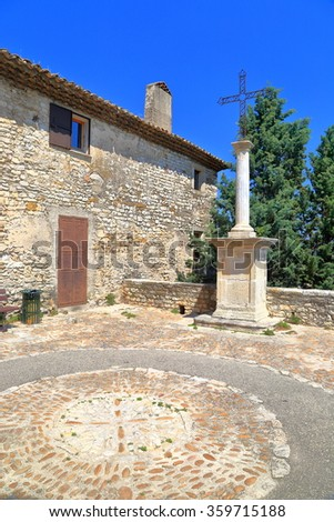 Christian cross near medieval church in the village of Vaison la Romaine, Provence, France