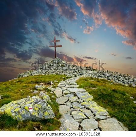 christian cross on a mountain top - stock photo