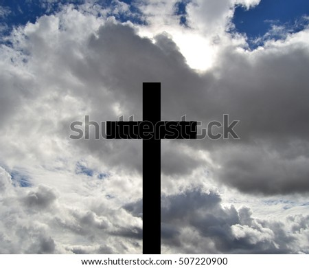 Christian cross on clouded sky for All Saintsâ?? Day