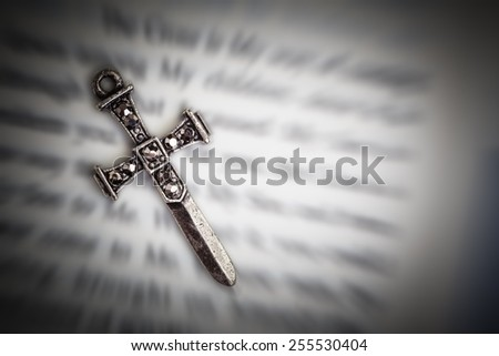 Christian cross on Holy Bible book, Jesus religion concept as good friday or easter festival - stock photo