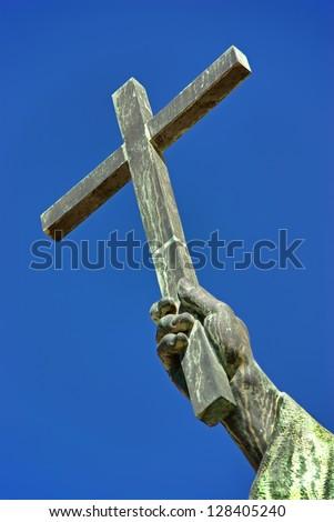 Christian cross over an sky background - stock photo