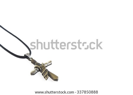 Christian Cross With Angel Wing Necklace On White Background - stock photo