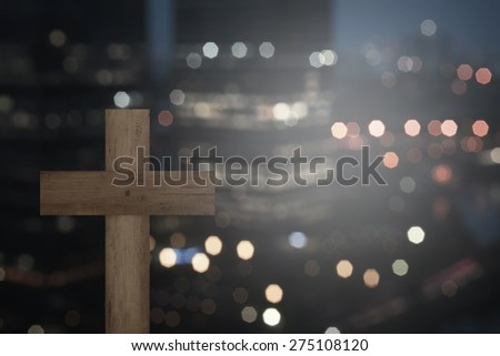 Christian cross with blurry city at night - stock photo