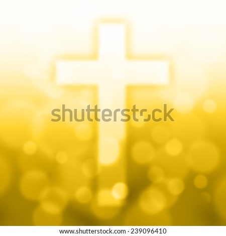 christian cross with bokeh light background,yellow color tone - stock photo