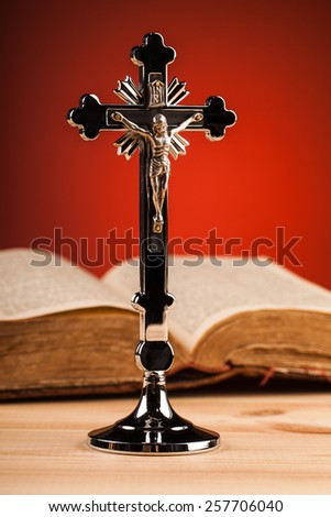 Christian crucifix composition on wooden table - stock photo