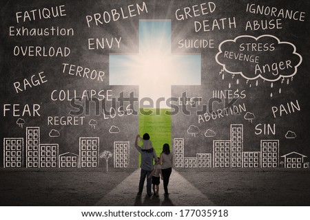 Christian family walking towards Cross of Jesus outdoor - stock photo