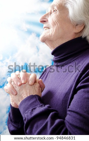 Christian religious senior woman praying to God - stock photo