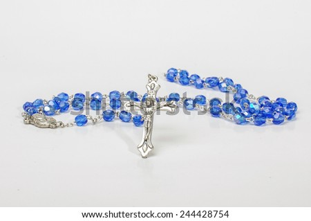 Christian rosary isolated - stock photo