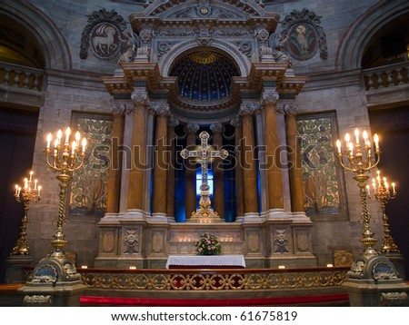 Christianity - Beautiful alter in a church with lit candles and flowers