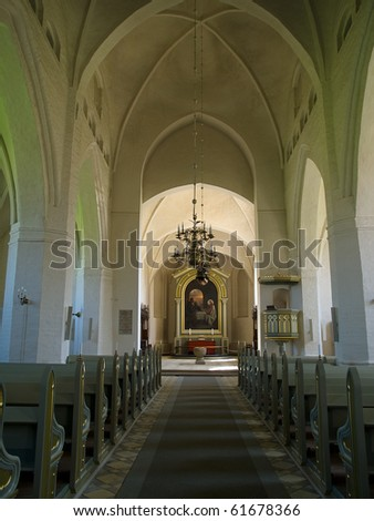 Christianity - Beautiful alter inside a church with lit candles and baptismal pond - stock photo