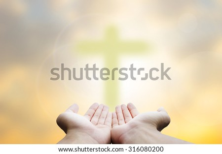 Christianity:Believe in God,Crucifix in Hand - stock photo