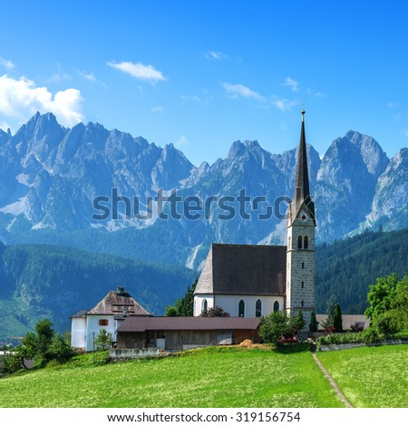 Christianity churh in Gosau village at sunny day. Alps, Austria, Europe. - stock photo