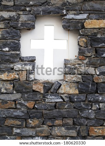 Christianity representation with the symbol of a cross on parchment, cross in brick wall, Belgrade, Serbia - stock photo
