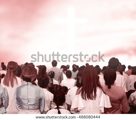 Christians prayed together in the church ,Large group of people seen from above gathered together around the shape of a cross, on white background,A man and woman praying together with their Bibles