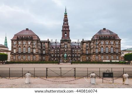 Christiansborg palace in Copenhagen, Denmark. Famous landmark of danish capital. Christiansborg castle, the seat of parliament on Slotsholmen. - stock photo
