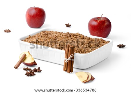 Christma still life consisting of red apples, cinammon and apple crumble against white background. - stock photo