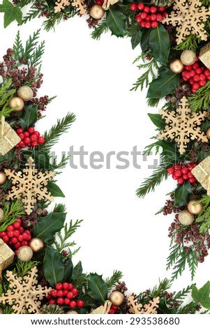 Christmas abstract background border with gold snowflake decorations, round and gift box baubles,  holly, ivy and fir over white. - stock photo