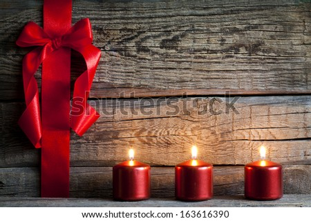 Christmas abstract background with red ribbon on vintage boards - stock photo